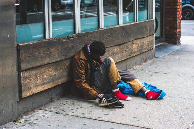 man-sitting-on-street-2239908.jpg