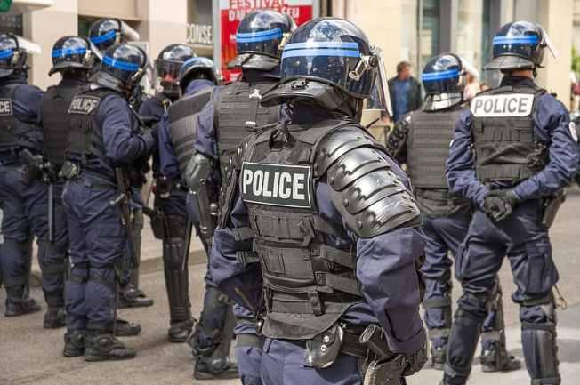 group-of-men-in-black-police-uniform.jpg